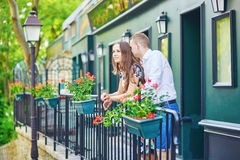 Romantic couple on the balcony decorated with flowers. On Montmartre, Paris Stock Image