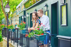 Romantic couple on the balcony decorated with flowers. On Montmartre, Paris Stock Photography