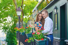 Romantic couple on the balcony decorated with flowers. On Montmartre, Paris Royalty Free Stock Images
