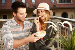 Romantic couple on balcony Stock Photos
