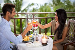 Romantic couple on the balcony toasting. During dinner Royalty Free Stock Photos