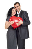 Romantic couple with balloon in shape of heart, beautiful woman and man isolated on white background Stock Photos