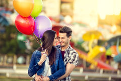 Romantic couple with balloons Stock Photos