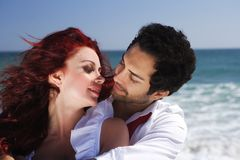 Romantic couple at the beach Stock Photography