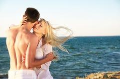 Romantic couple on the beach Stock Photos