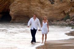 Romantic couple on beach Stock Images