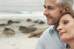 Romantic Couple At Beach. Closeup of romantic couple looking away at beach Stock Photos