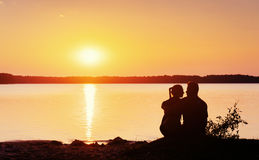 Romantic couple on the beach at colorful sunset  background. Romantic couple on the beach at colorful sunset on background Stock Images