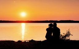 Romantic couple on the beach at colorful sunset  background. Romantic couple on the beach at colorful sunset on background Royalty Free Stock Photography