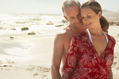 Romantic Couple At Beach. Happy romantic couple standing at beach Stock Photography