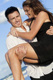 Romantic Couple On Beach, Man Carrying his Woman Royalty Free Stock Photos