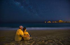 Romantic Couple On Beach At Night in Cabo San Lucas Mexico. Cabo San Lucas Mexico Beach with Romantic Couple at Night Royalty Free Stock Image