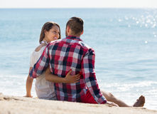 Romantic couple on beach at sunny day Stock Image