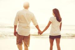 Romantic Couple on the Beach at Sunset. Stock Photo