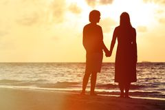 Romantic couple on the beach at sunset Royalty Free Stock Images
