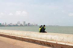 Romantic couple on beach wall mumbai india Royalty Free Stock Images