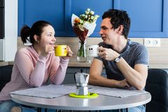Cheerful beautiful young couple at home Stock Photography