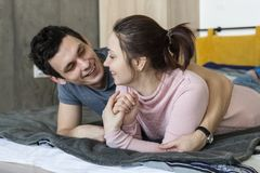 Cheerful beautiful young couple at home Stock Image