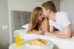 Romantic couple in bed Royalty Free Stock Photography