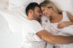Romantic couple in bed in nightwear Stock Photo