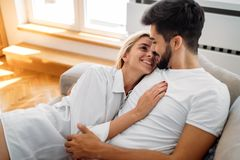 Romantic couple in bed. Romantic cute couple in bed being intimate royalty free stock photography