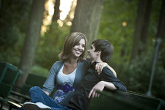Romantic couple on bench Stock Photos