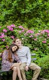 Romantic couple on bench in garden Stock Image