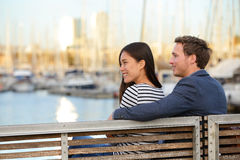 Romantic couple on bench Port Vell, Barcelona Stock Photography