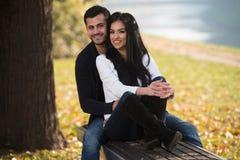 Romantic Couple On A Bench Stock Photo
