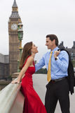 Romantic Couple by Big Ben, London, England. Romantic man and woman couple on Westminster Bridge with Big Ben in the background, London, England, Great Britain Royalty Free Stock Photos
