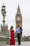 Romantic Couple by Big Ben, London, England. Romantic man and woman couple on Westminster Bridge with Big Ben in the background, London, England, Great Britain Royalty Free Stock Image
