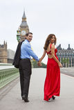Romantic Couple by Big Ben, London, England. Romantic man and woman couple on Westminster Bridge with Big Ben in the background, London, England, Great Britain Royalty Free Stock Photo