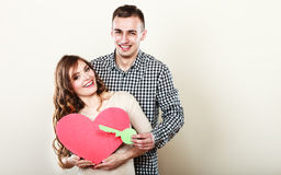Romantic couple with big heart and key Stock Photo