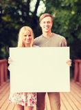 Romantic couple with blank white board Royalty Free Stock Photos