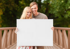 Romantic couple with blank white board Stock Image