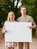Romantic couple with blank white board Royalty Free Stock Photo