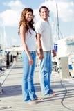 Romantic couple on boardwalk Stock Photos