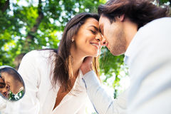 Romantic couple bonding affectionatley outdoors Royalty Free Stock Photography