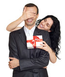 Romantic couple with box gift, woman close his eyes and make surprise, dressed in black suit, isolated white Stock Images