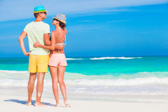 Romantic couple in bright clothes enjoying sunny day at tropical beach Royalty Free Stock Image