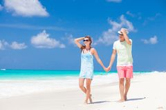 Romantic couple in bright clothes enjoying sunny Stock Photo