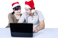 Romantic couple buying christmas gift online Stock Photography