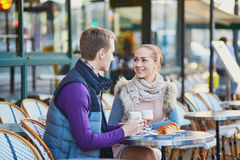 Romantic couple in cafe in Paris, France Royalty Free Stock Photography