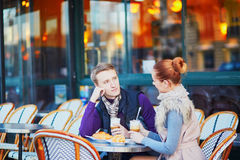Romantic couple in cafe in Paris, France Stock Images