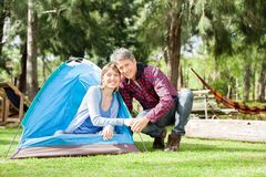 Romantic Couple Camping In Park. Portrait of romantic couple camping in park stock photos