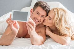 Romantic Couple Capturing Moments Royalty Free Stock Photography