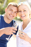 Romantic couple with champagne Stock Images