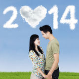 Romantic couple with clouds shaped 2014 Royalty Free Stock Images