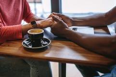 Romantic couple at a coffee shop Stock Photos