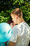 Romantic couple with colorful balloons outdoors Stock Photography